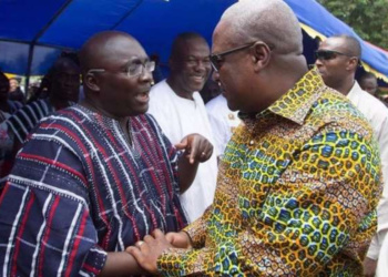 Vice President Dr Bawumia (l) interacting with Former President Mahama (r) at an event