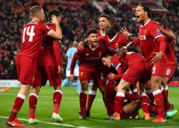 Liverpool FC team celebrating a victory