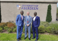Dr Dominic Eduah (left) and another official of GNPC (r) with a representative of Aberdeen University after the MOU