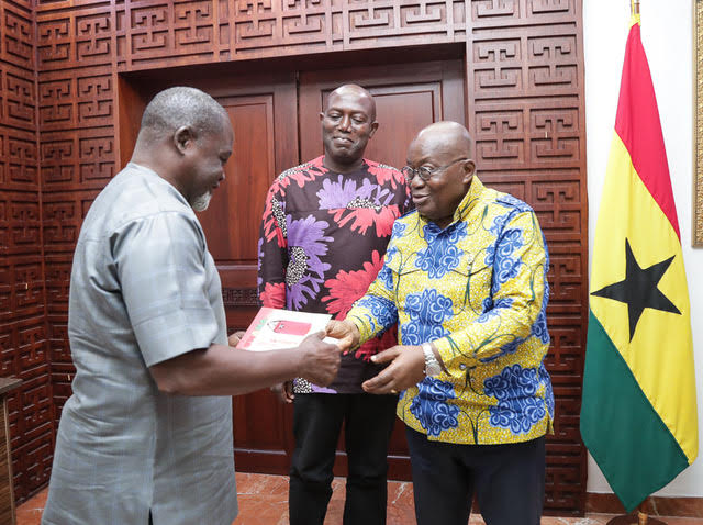 Azumah Nelson, Ghana's boxing legend, presenting a copy of the book to President Akufo-Addo whiles Ekow Asmah looks on
