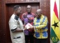 DK Poison, (left) presenting a copy of the book to President Akufo-Addo whiles Ekow Asmah looks on at the Jubilee House