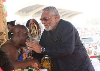 Former President Rawlings warmly embracing President Akufo-Addo