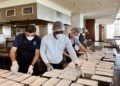 An image of Chefs at Kempinski packaging meals